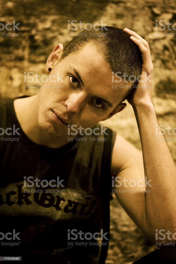 Close portrait of stern looking young man. royalty-free stock photo