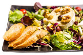 close salad gourmet goat cheese isolated white black dish bread