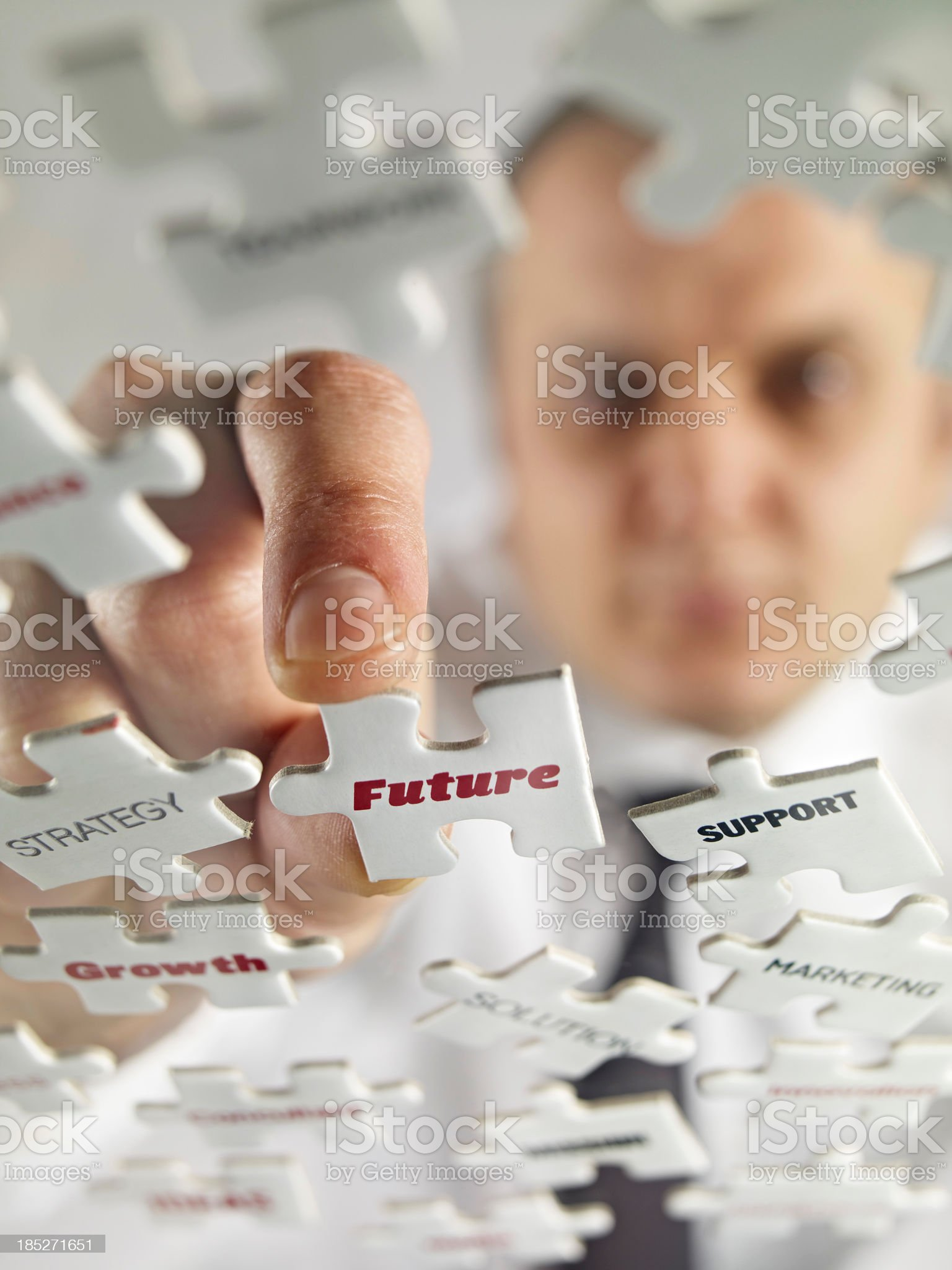 Close shot of puzzle pieces with words future and support  royalty-free stock photo