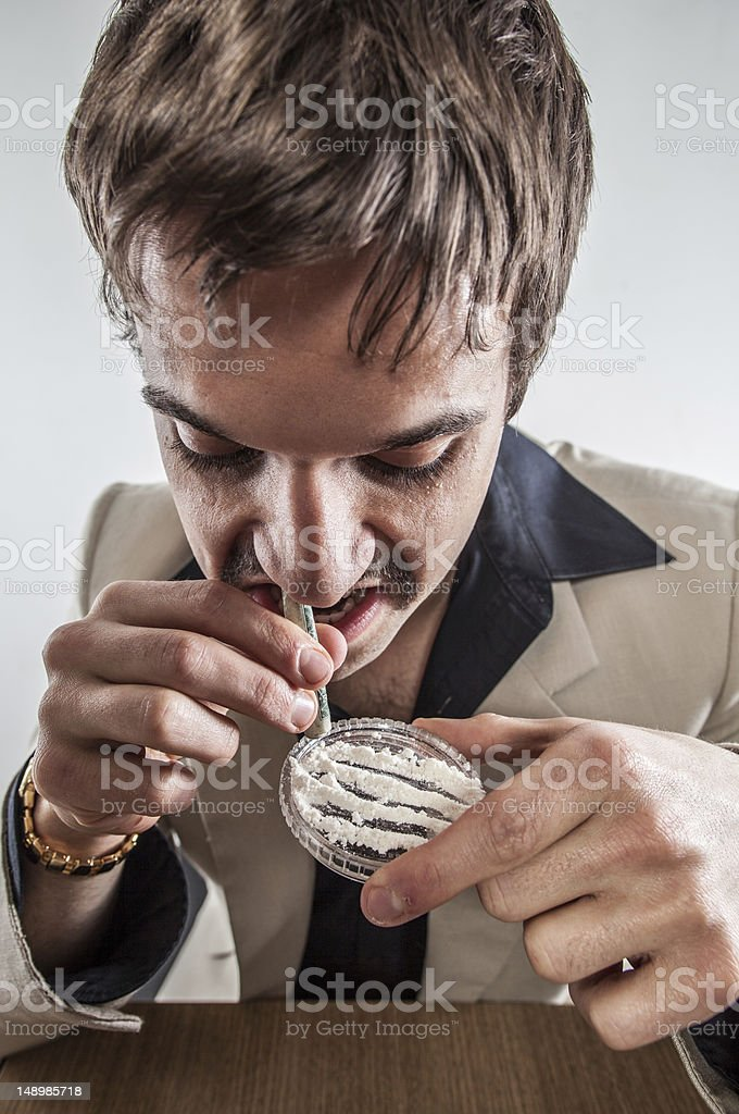 Close Up 70's Disco Guy Doing Huge Line Of Cocaine stock photo