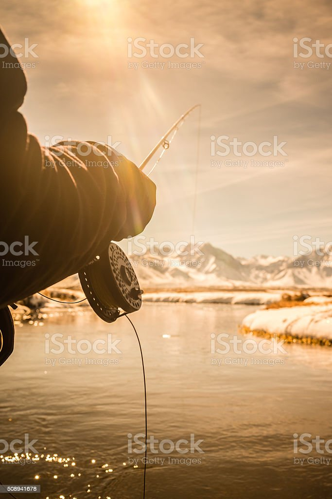 Close Up POV of a Fly Fishing Reel And Rod stock photo