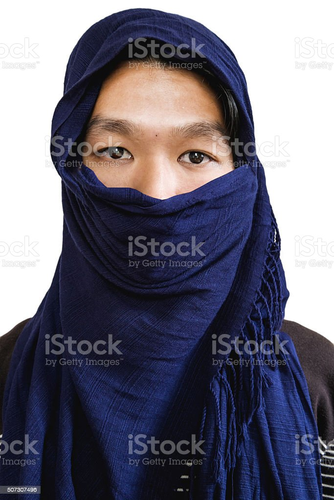 Close up a man under black head scarf, isolated stock photo