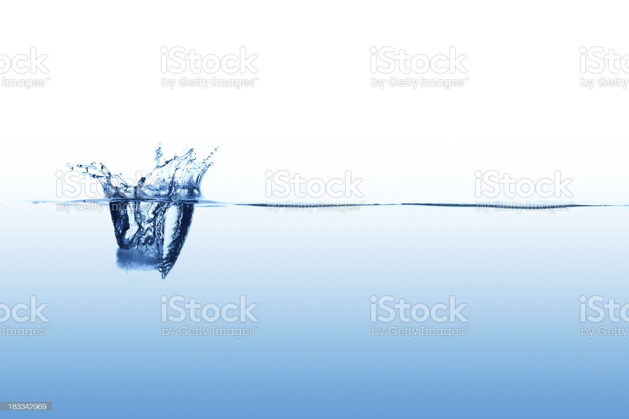 Close up abstract of single splash on calm surface royalty-free stock photo