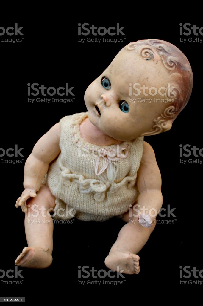 Close Up and Isolated Vintage Antique Old Doll stock photo