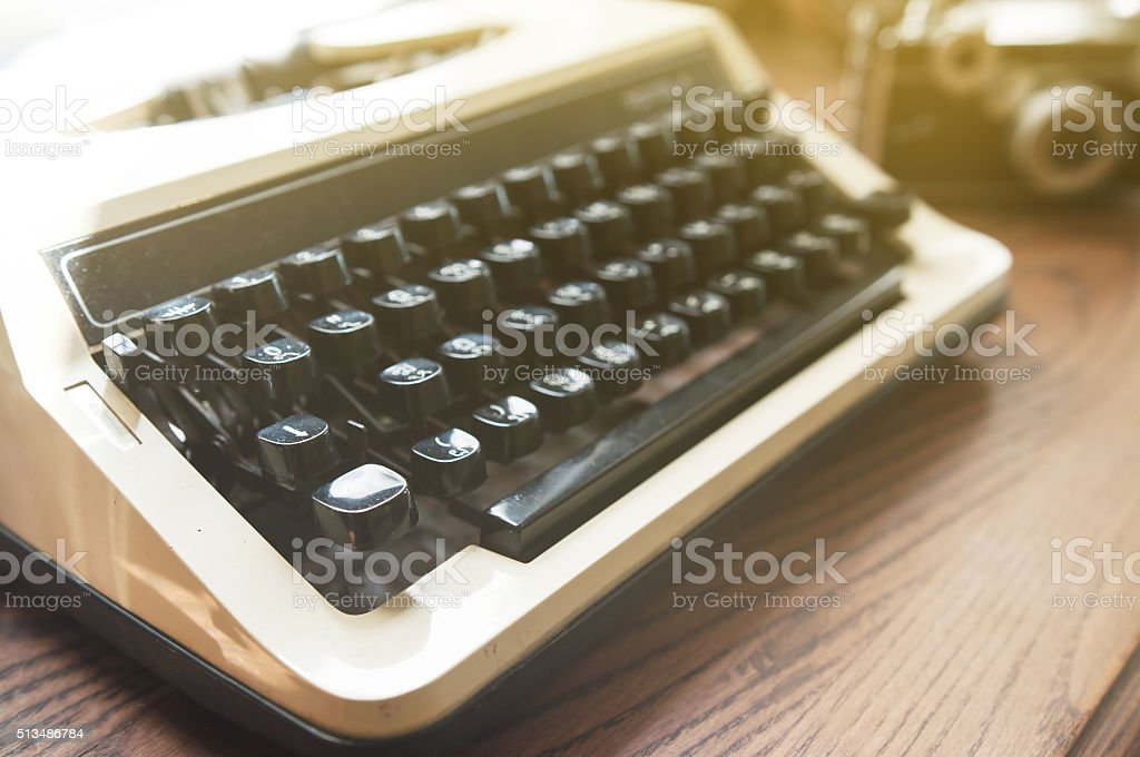 Close up and soft focus, old typewriter with vintage camera. stock photo