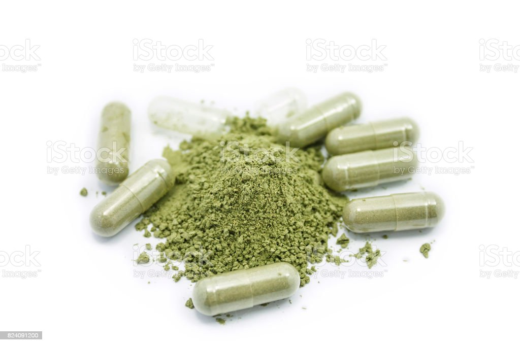 Close up andrographis paniculata herbal antipyretic capsules isolated on white stock photo