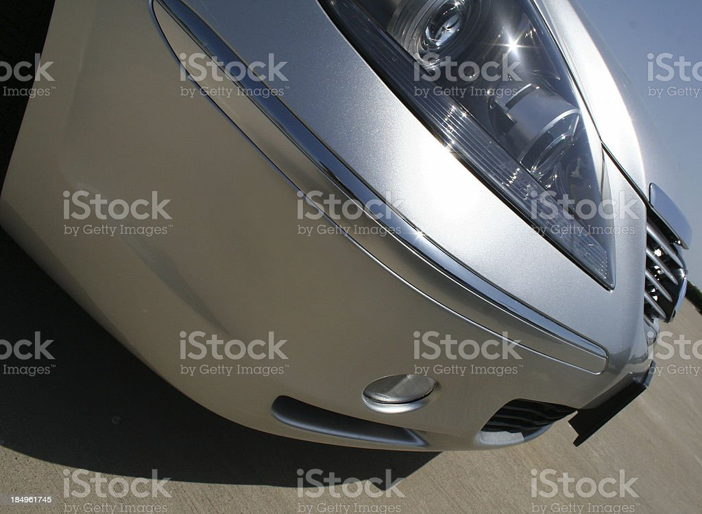 Close up angled photograph of a silver sedan car royalty-free stock photo