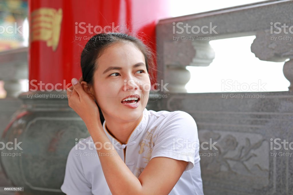 Close up asian woman in White traditional chinese dress at chinese temple in bangkok thailand. stock photo