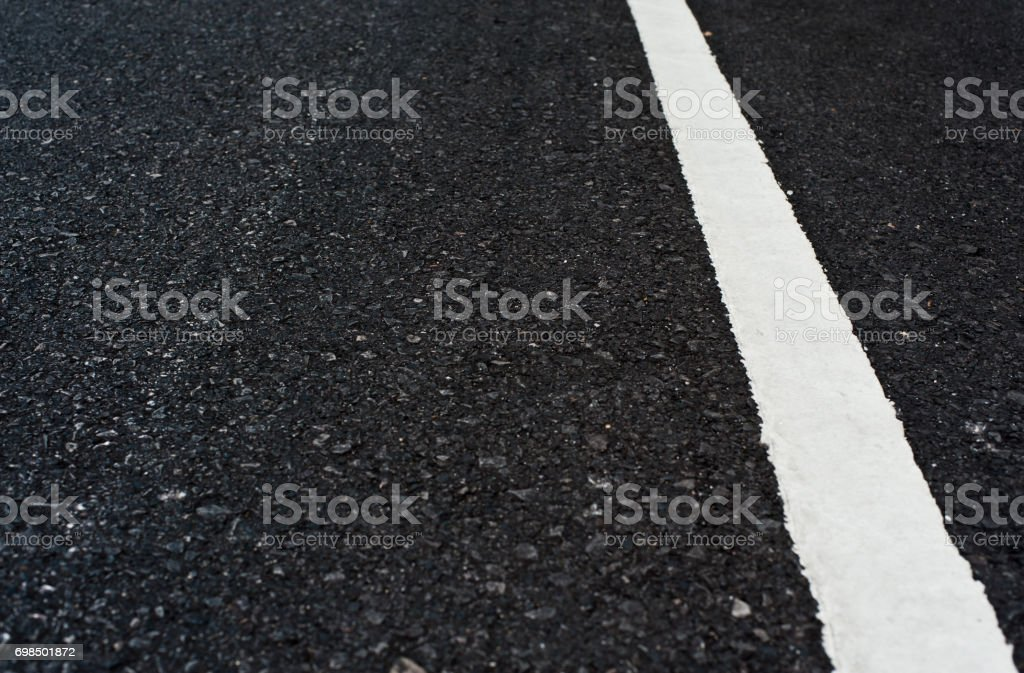 Close up asphalt surface of road divide white lines stock photo