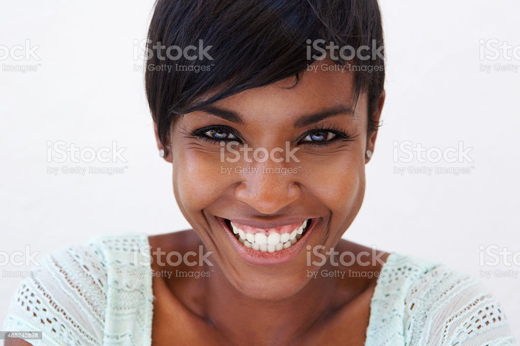 Close up attractive african american woman smiling stock photo