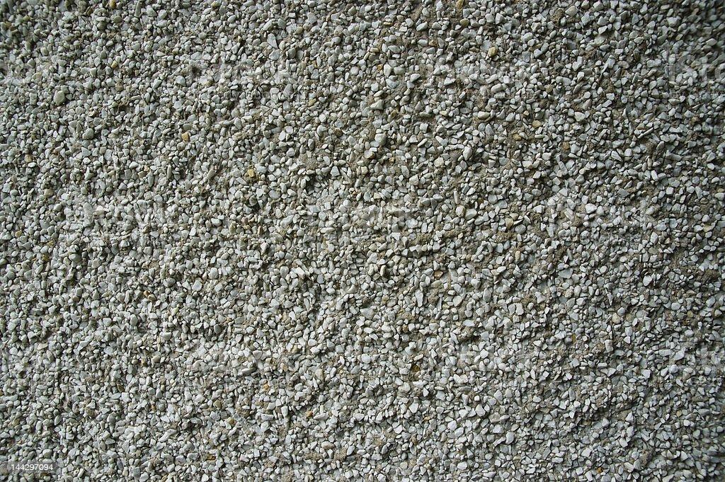 Close up background of an off-white pebbledashed wall royalty-free stock photo