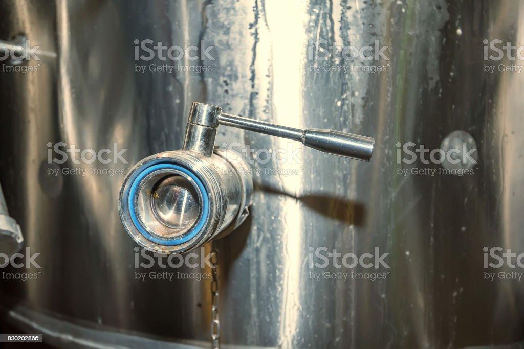 Close up ball valve on water tank stock photo