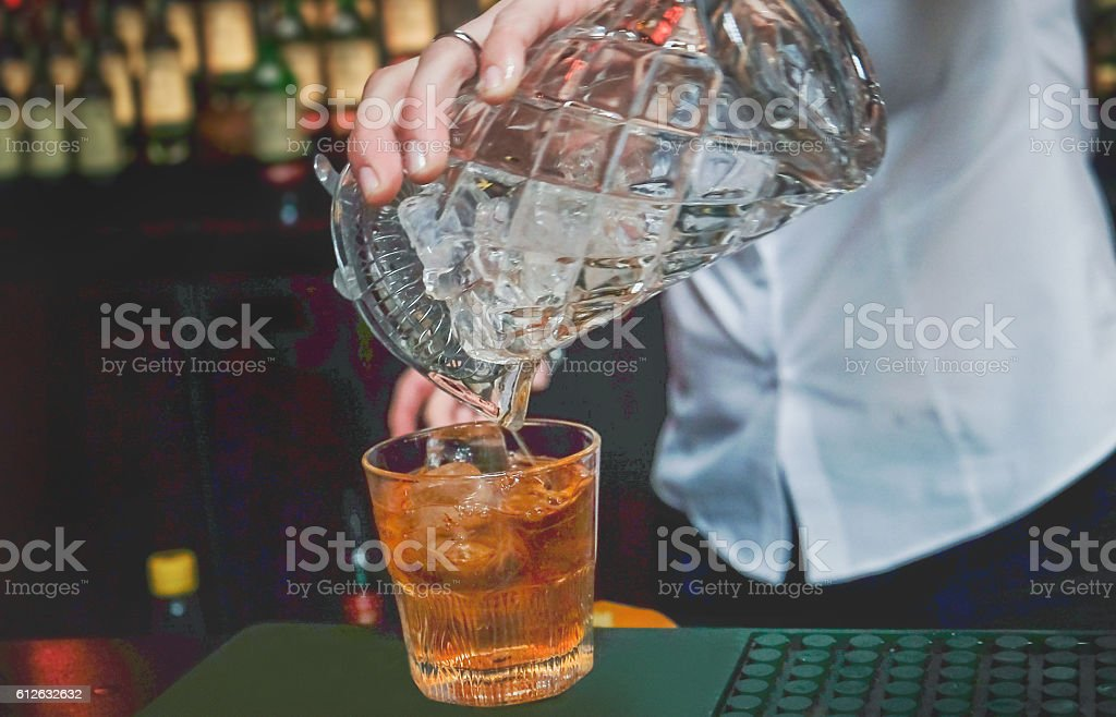 Close up bartender hands pouring whiskey stock photo