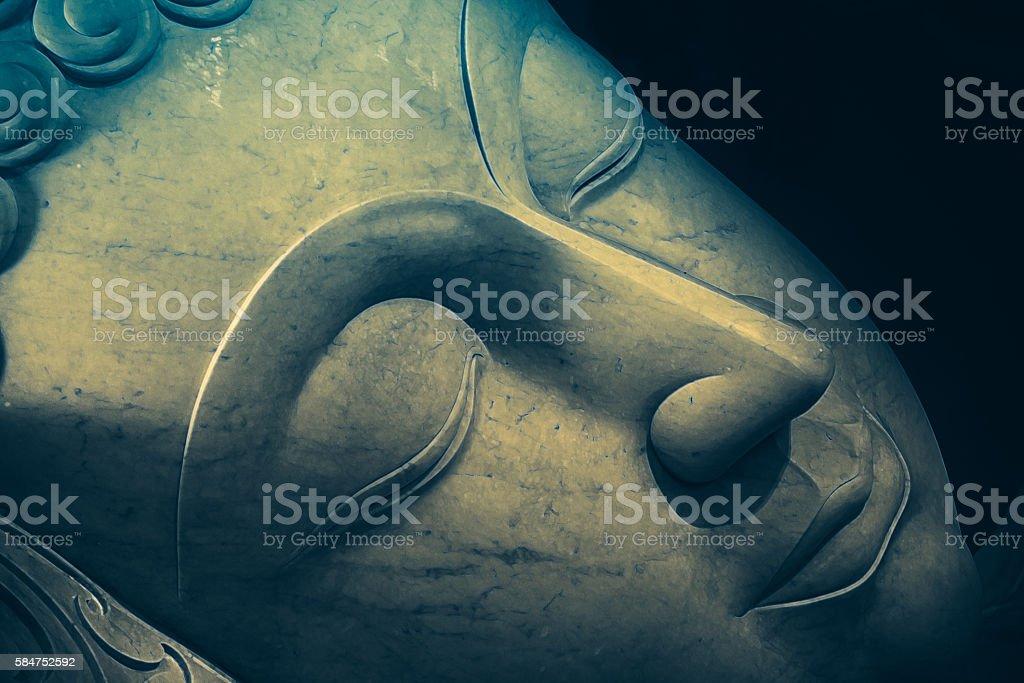 Close up beautiful sleeping Buddha face with painting art effect. stock photo