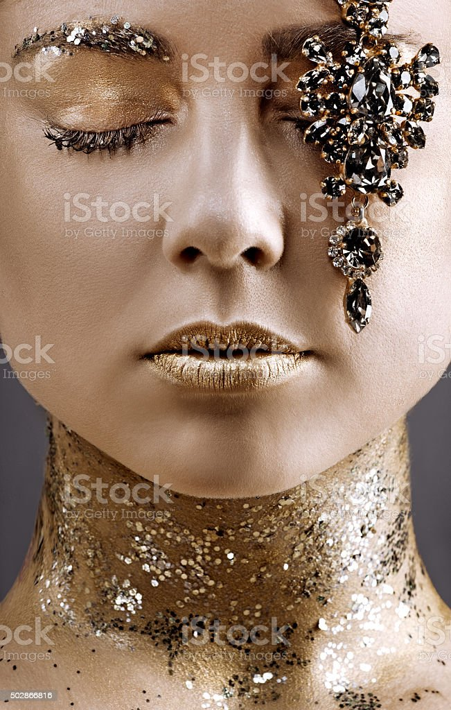 close up beautiful woman posing with luxury jewellery stock photo