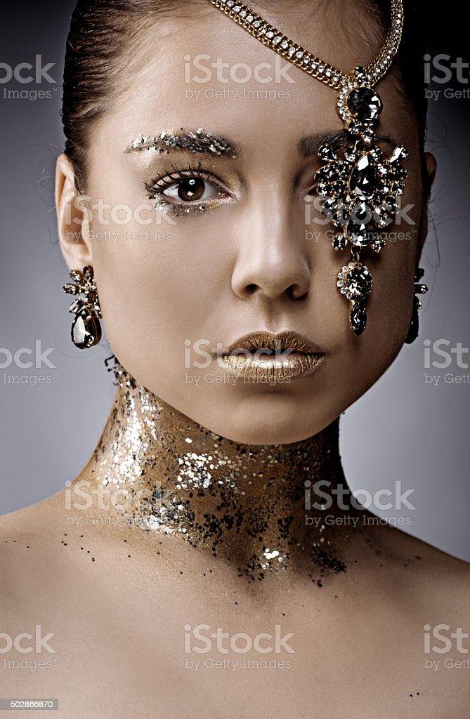 close up beautiful woman posing with luxury jewellery stock photo