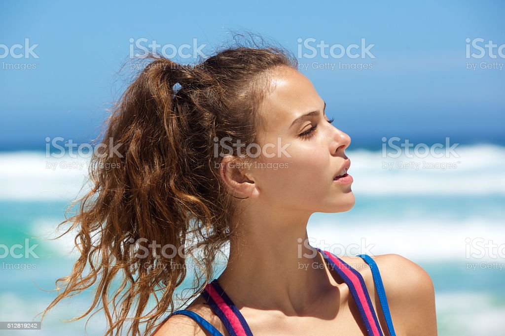 Close up beautiful young woman at the beach stock photo