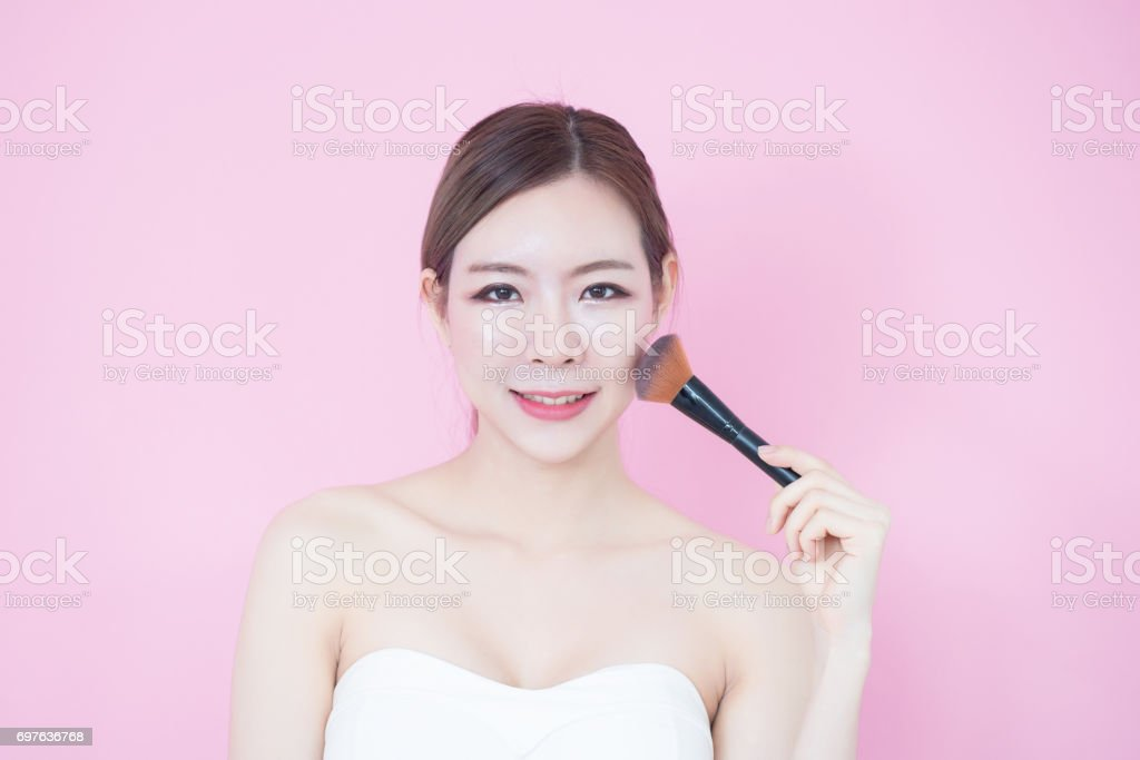 Close up Beautiful young woman with clean fresh skin with pink background stock photo