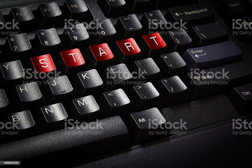close up black keyboard word start on red button stock photo