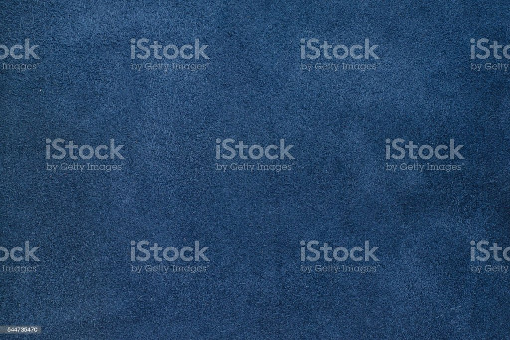 Close up blue color crumpled leather texture background stock photo