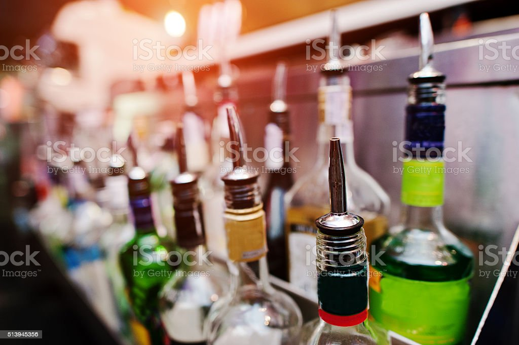 Close up bottles of alcohol and liquor at the bar stock photo
