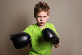 Close up Boxer Boy Wearing Hand Gloves and Looking Fierce