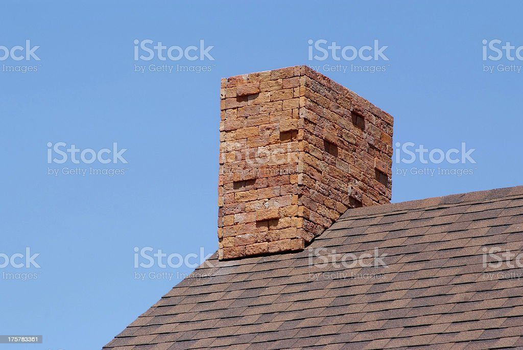 Close up brick chimney on the roof stock photo