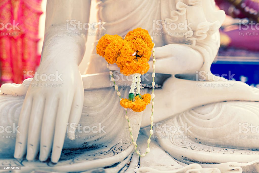 Close up Buddha statue hands stock photo