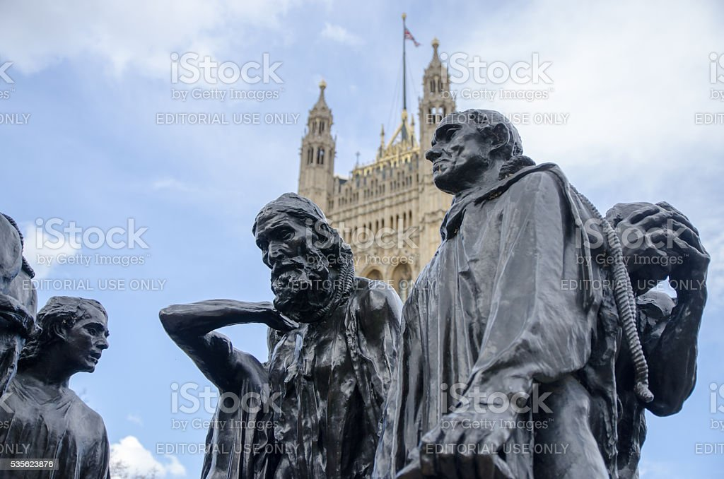 Close up Burghers of calais (Rodin) with Westminster Abbey behind stock photo