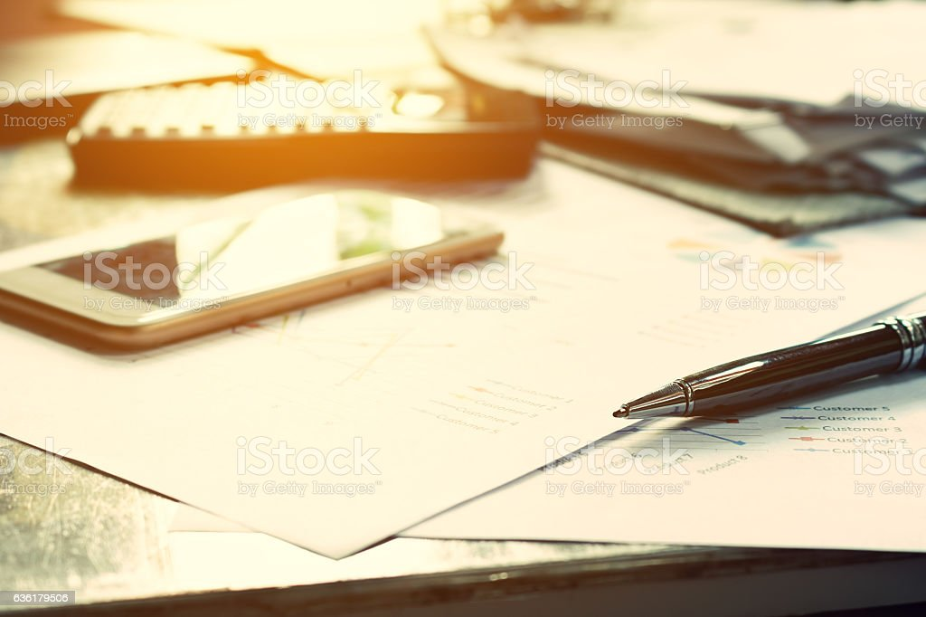 Close up business concept, Pen on summary report and calculator stock photo