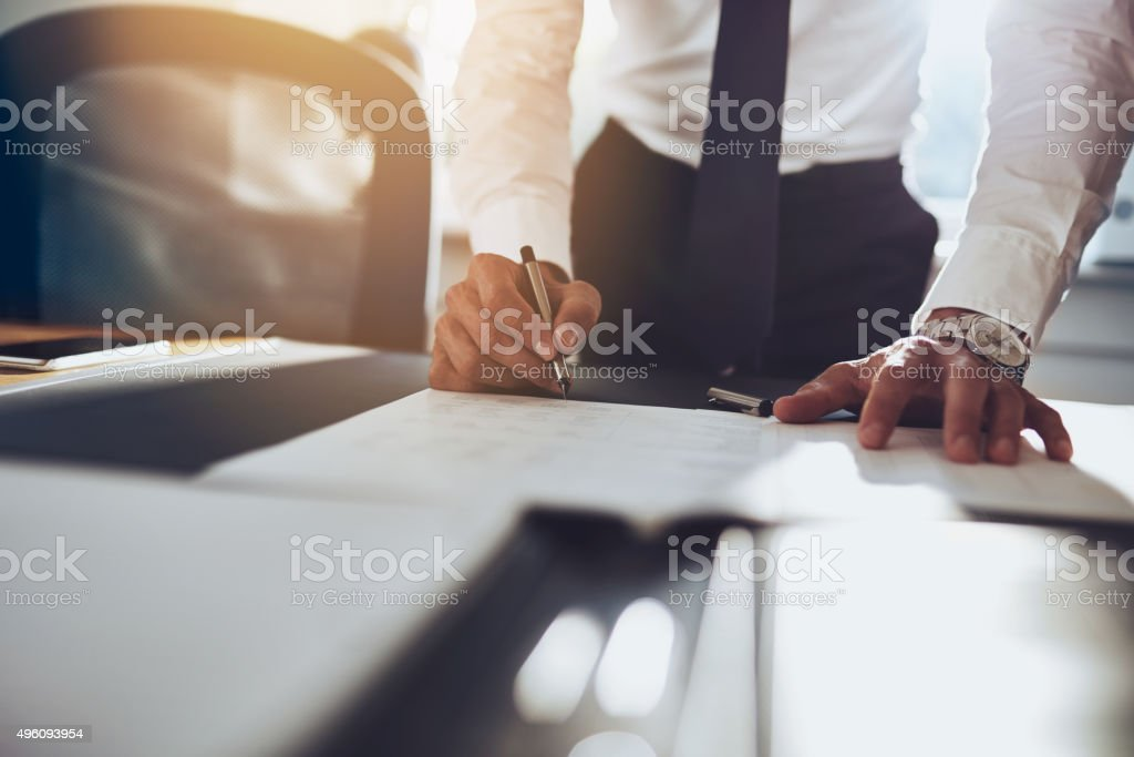 Close up business man signing contract stock photo