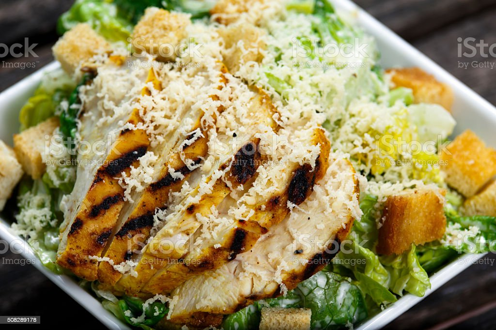 Close Up Caesar salad with chicken and lettuce stock photo