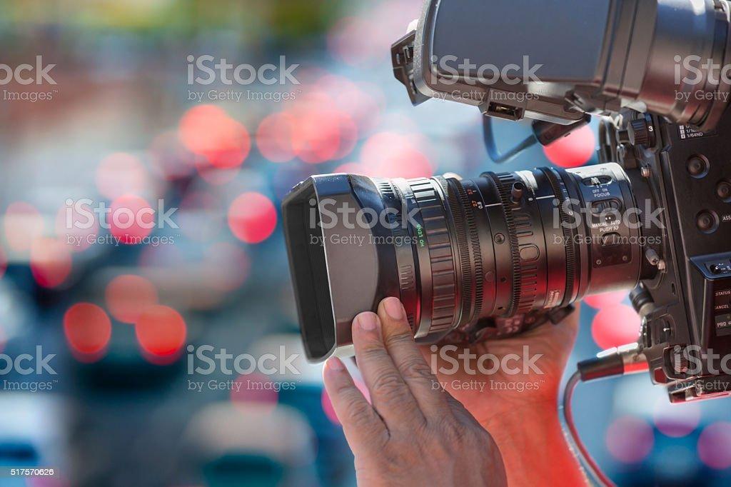 Close up cameraman at work outdoors stock photo