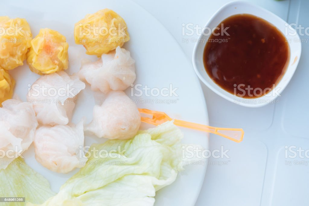 Close up Chinese steamed shrimp or pork dumpling the kind of delicious Chinese snacks on the white dish. stock photo
