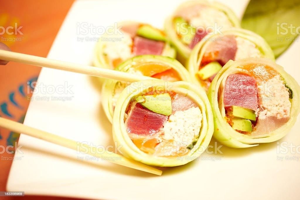 Close up chopsticks selecting a piece of sushi stock photo