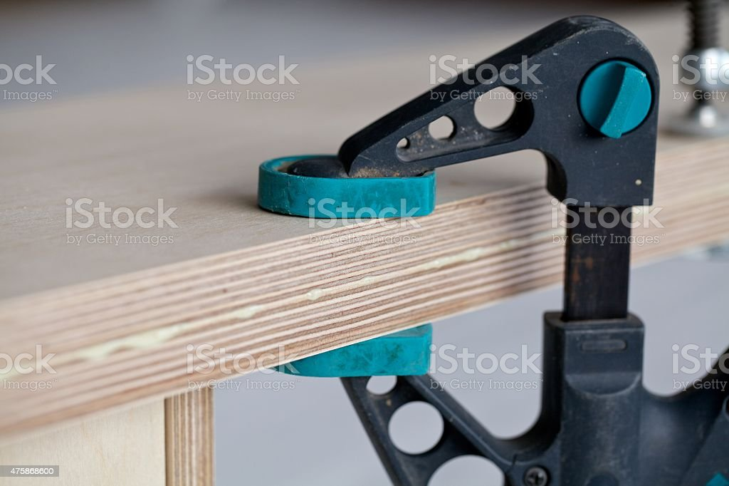 Close up clamps holding stock photo
