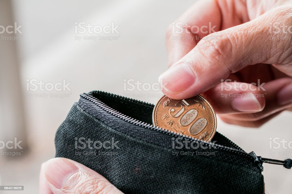 Close up coin with small money pouch stock photo