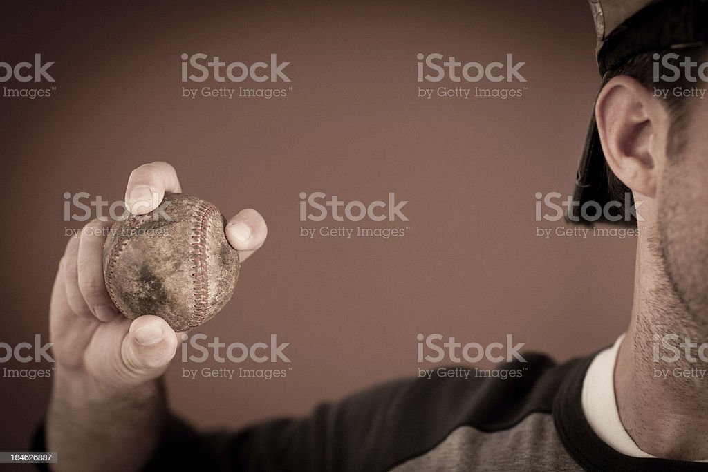 Close Up Color Image of Baseball Player Holding Vintage Ball royalty-free stock photo