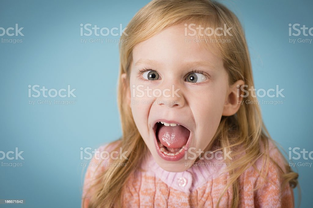 Close Up, Color Image of Little Girl Making  Funny Face royalty-free stock photo