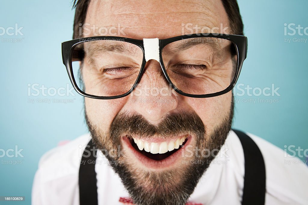 Close Up Color Image of Nerdy Guy With Cheesy Grin stock photo