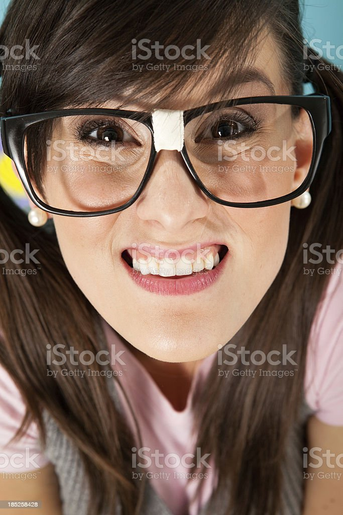Close Up, Color Image of Nerdy Woman's Smiling Face stock photo