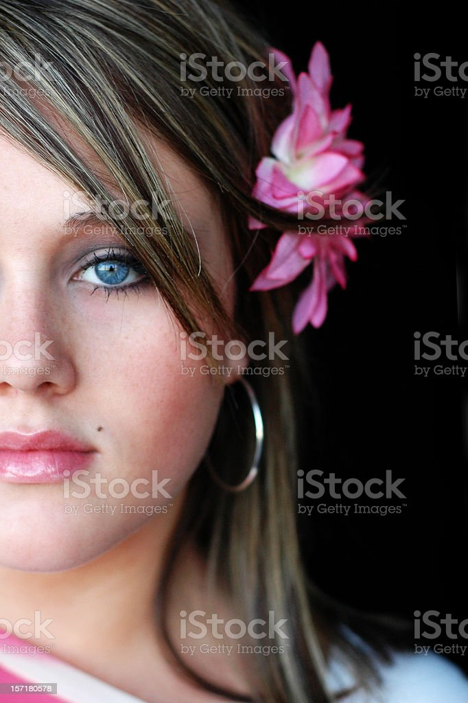 Close Up Color Image of Pretty Teenage Girl, Black Background stock photo