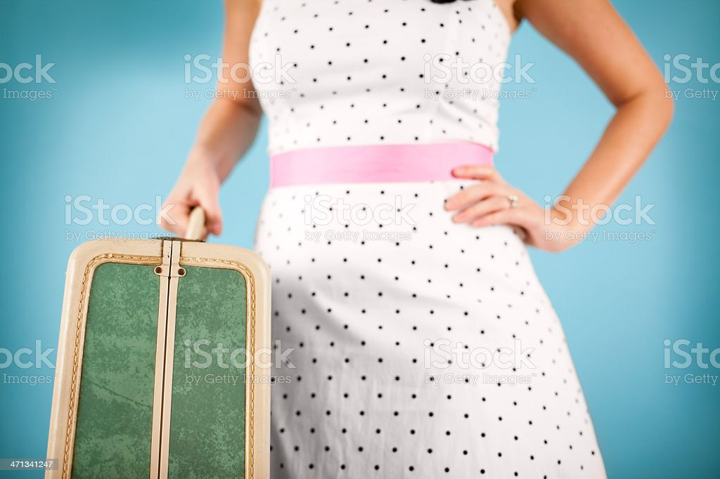 Close Up Color Image of Retro Gal Holding Vintage Suitcase royalty-free stock photo