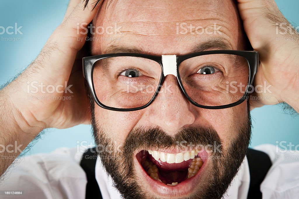 Close Up Color Image of Stressed/Frustrated Nerdy Guy stock photo