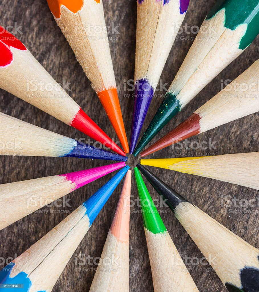 Close up Color pencils on wood background stock photo