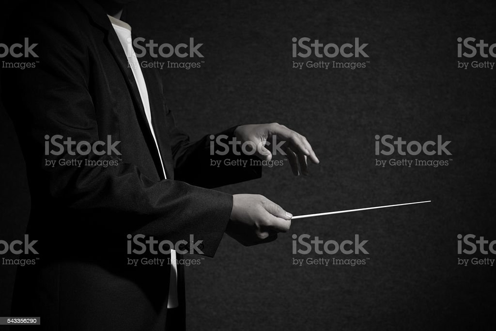 close up conductor in dark stock photo