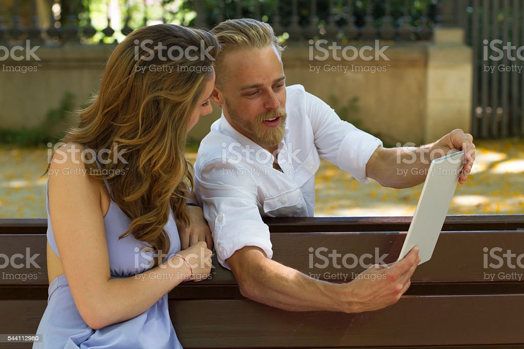 Close up couple image with digital tablet stock photo