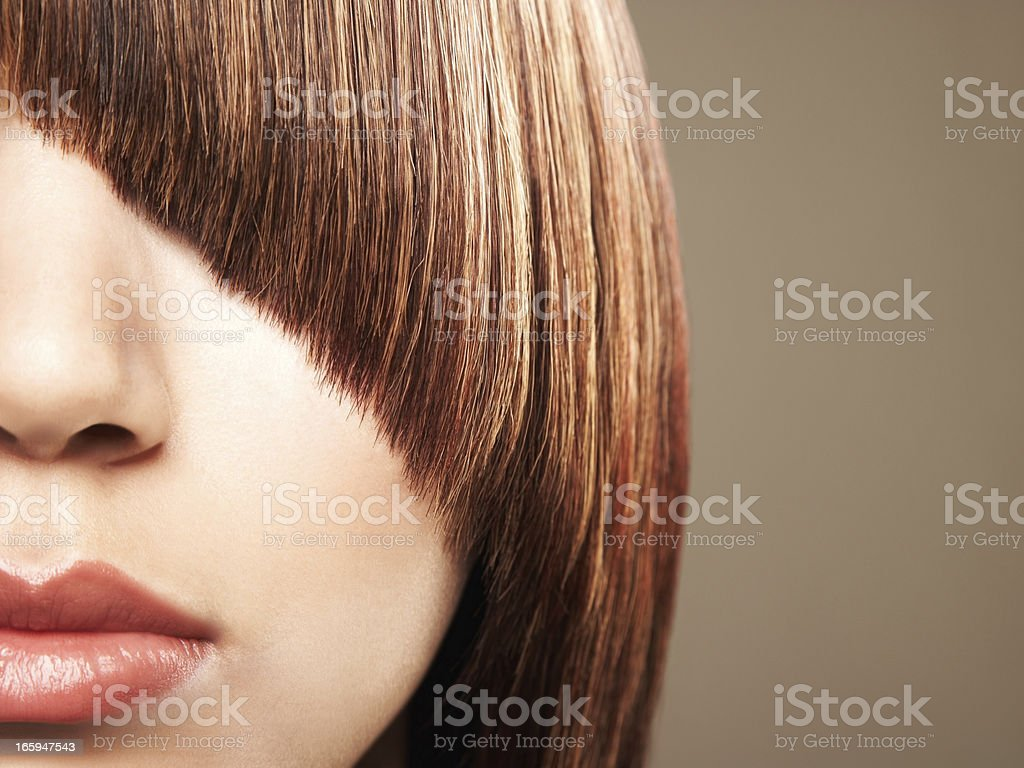 Close up crop of woman's bangs coverin her eye royalty-free stock photo