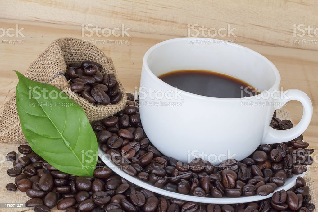 close up cup and coffee beans royalty-free stock photo