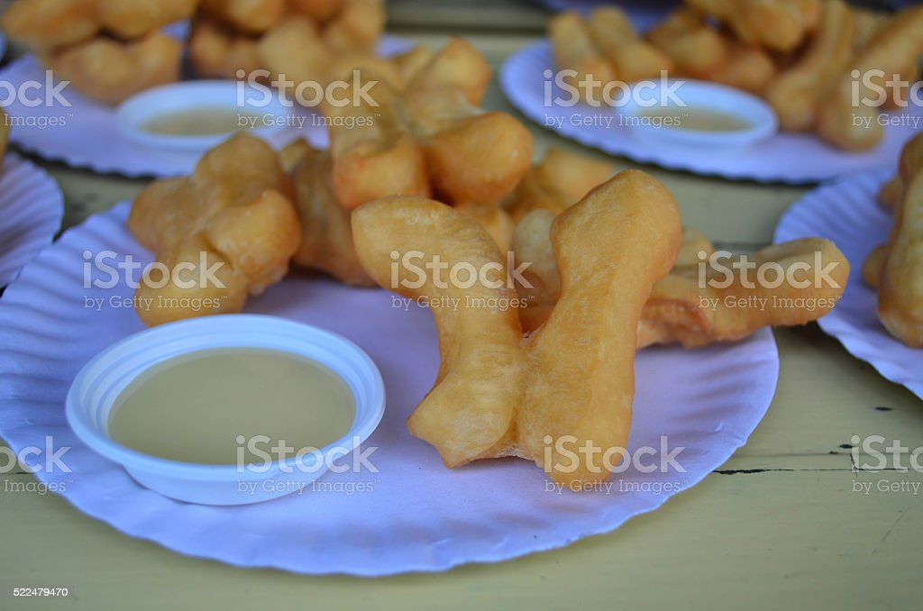 Close up deep-fried dough stick with sweetened condensed milk di stock photo